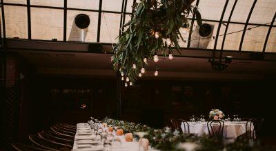 Serafino floral installation, moody reception lighting, open ceiling