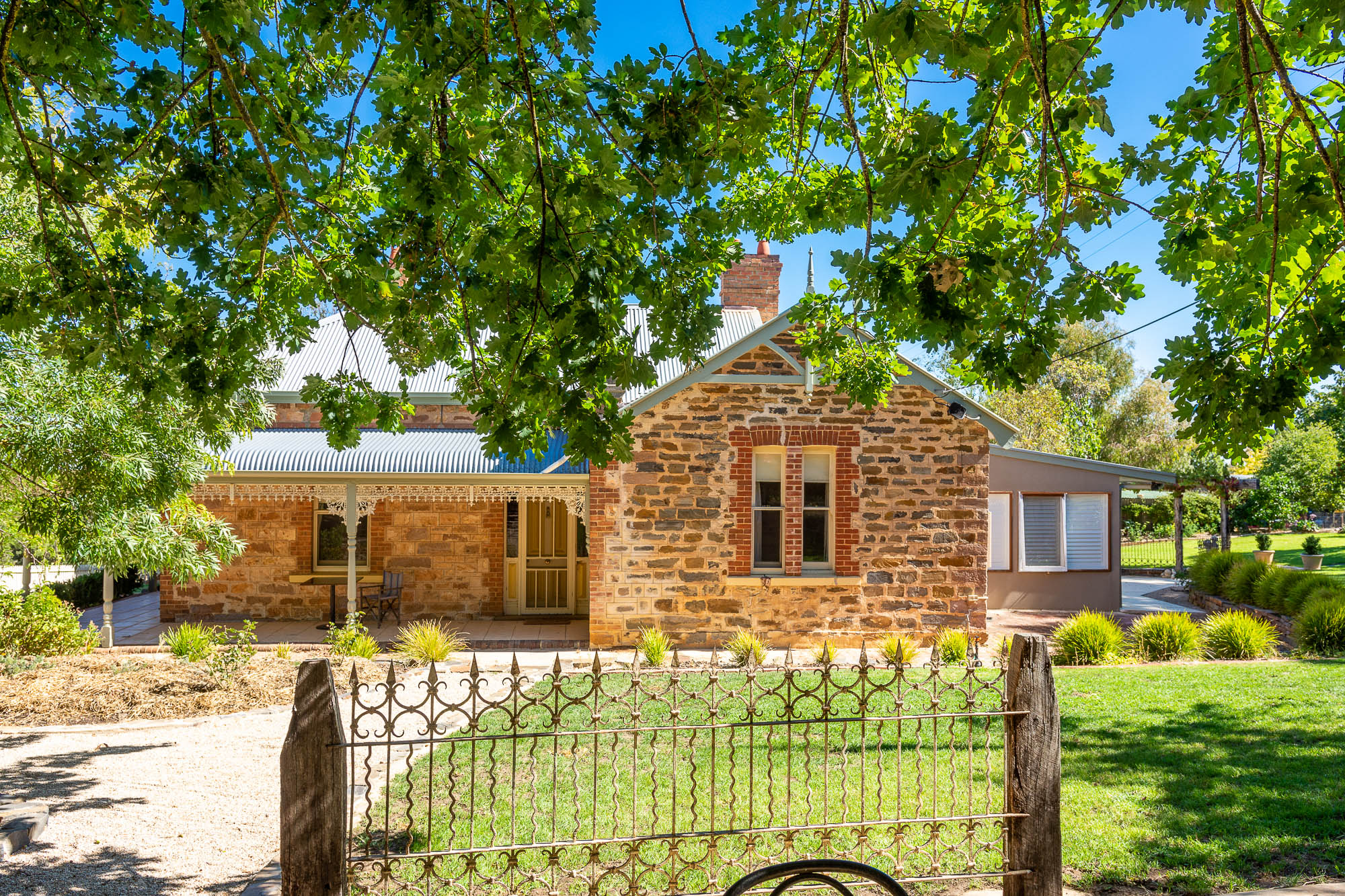Morning Star, historic Adelaide Hills wedding venue minutes from Mt Barker, with formal gardens, Bluestone courtyard and rustic stables bar and reception space.